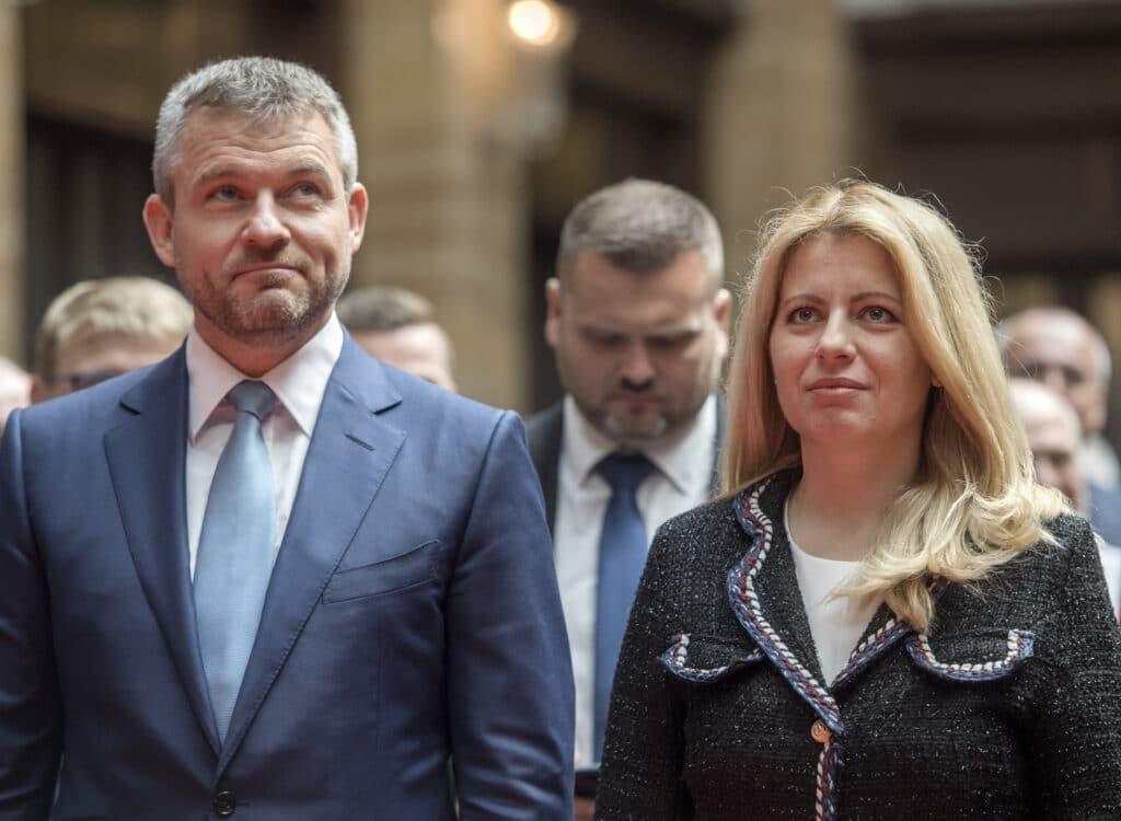 Na archívnej snímke prezidentka Zuzana Čaputová a vľavo Peter Pellegrini. Foto: TASR - Martin Baumann